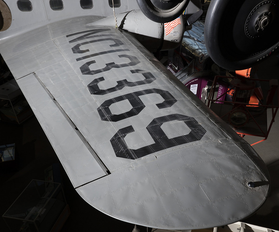 Wing of gray Boeing 247-D aircraft with 'NC13369' in black lettering