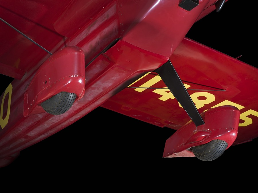 Two wheels and landing gear on red Wittman Special 20 'Buster' aircraft