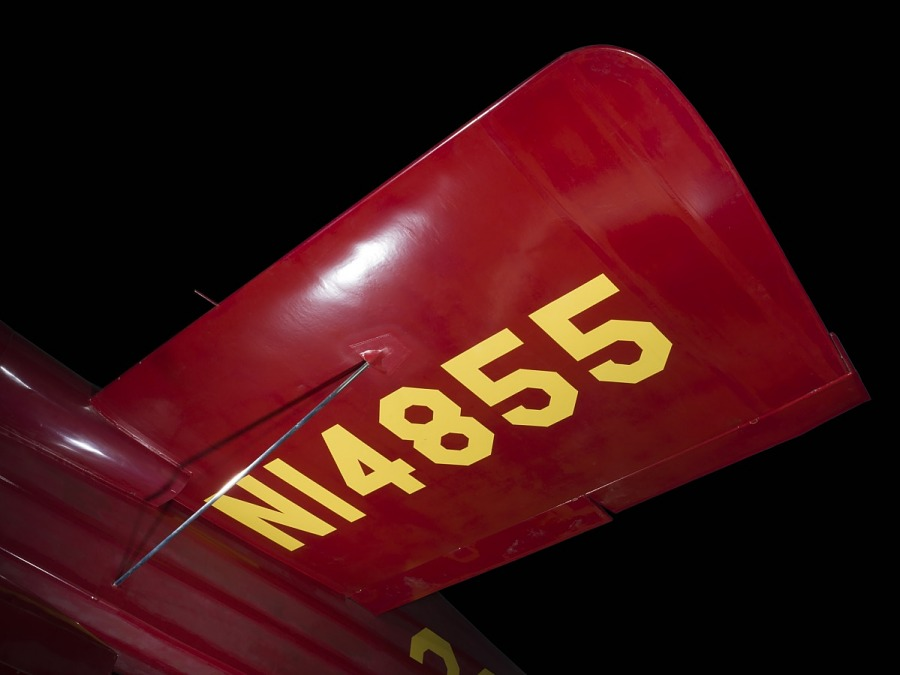 """Wing of red Wittman Special 20 """"Buster"""" aircraft with """"NI4855"""" in yellow lettering"""