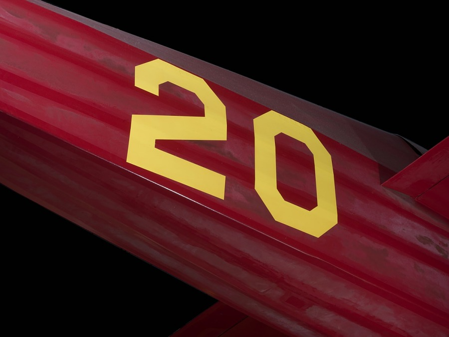 """Yellow """"20"""" on body of red Wittman Special 20 """"Buster"""" aircraft"""