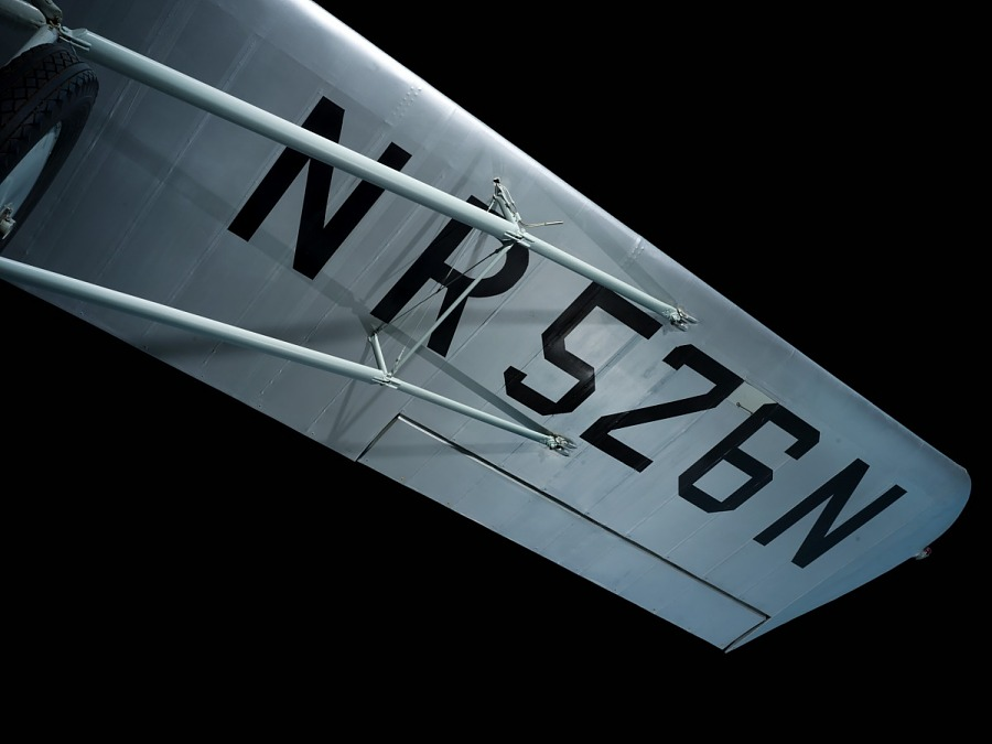 """Blue underwing of a Curtiss Robin J-1 Deluxe marked with """"NR526N"""" in black lettering"""