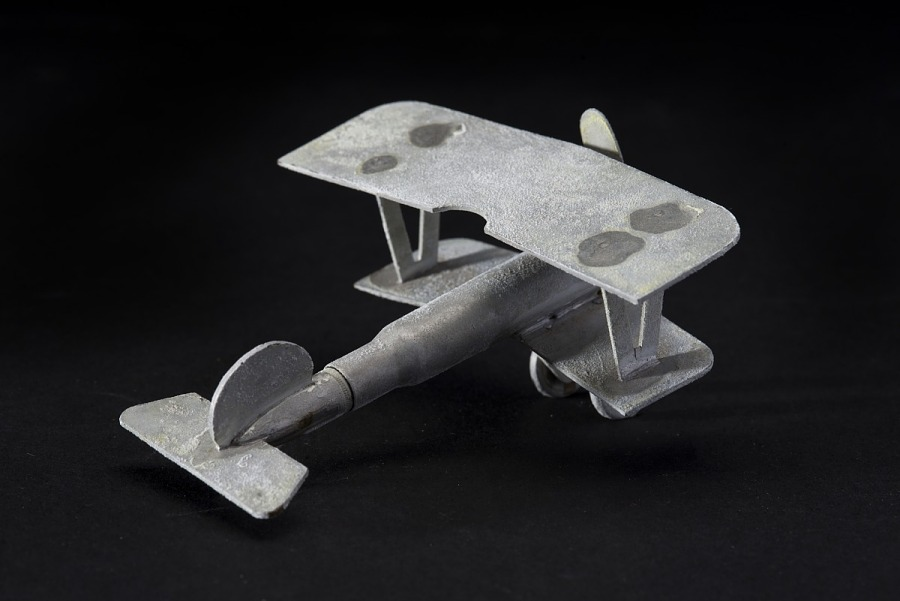 Rear of frosted brass miniature model of French propeller aircraft