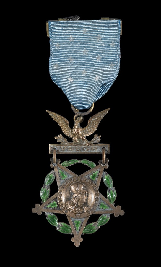 Golden five-point star medal encircled with emerald wreath hanging on eagle with blue ribbon