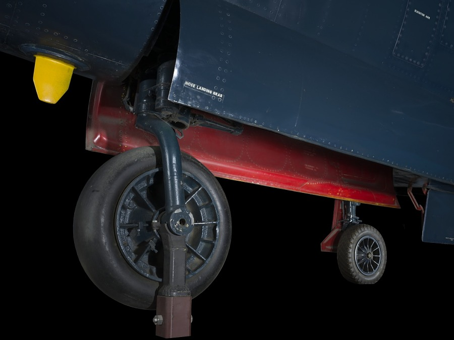 Larger wheel and smaller wheel with landing gear of blue McDonnell FH-1 Phantom I aircraft