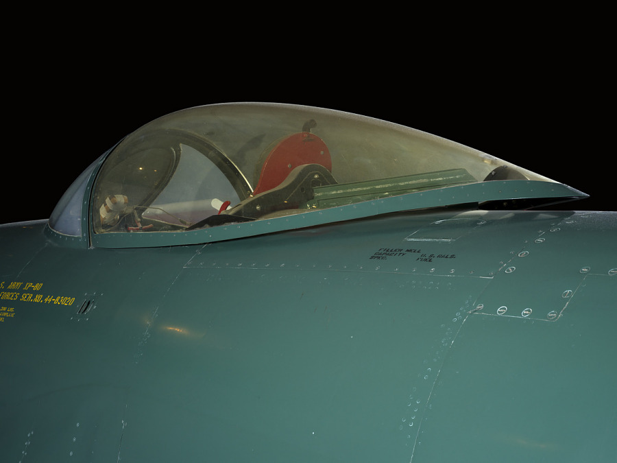 Outside of cockpit of green Lockheed XP-80 'Lulu Belle' aircraft with red seat
