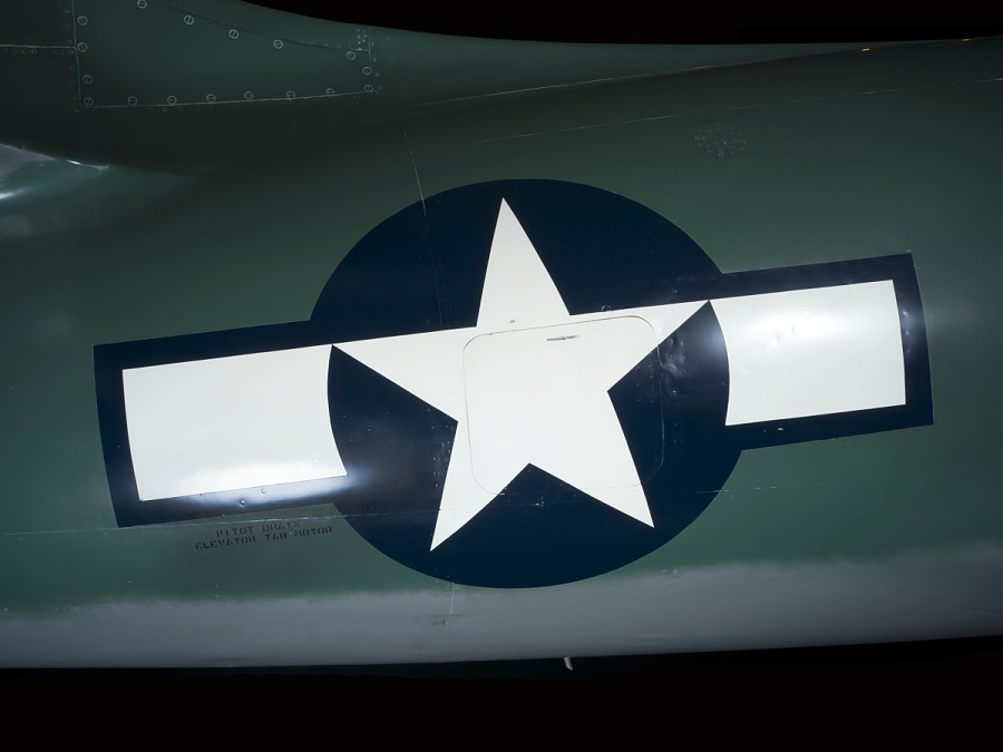 United States Air Force white star in navy blue circle insignia on green Lockheed XP-80 'Lulu                 Belle' aircraft
