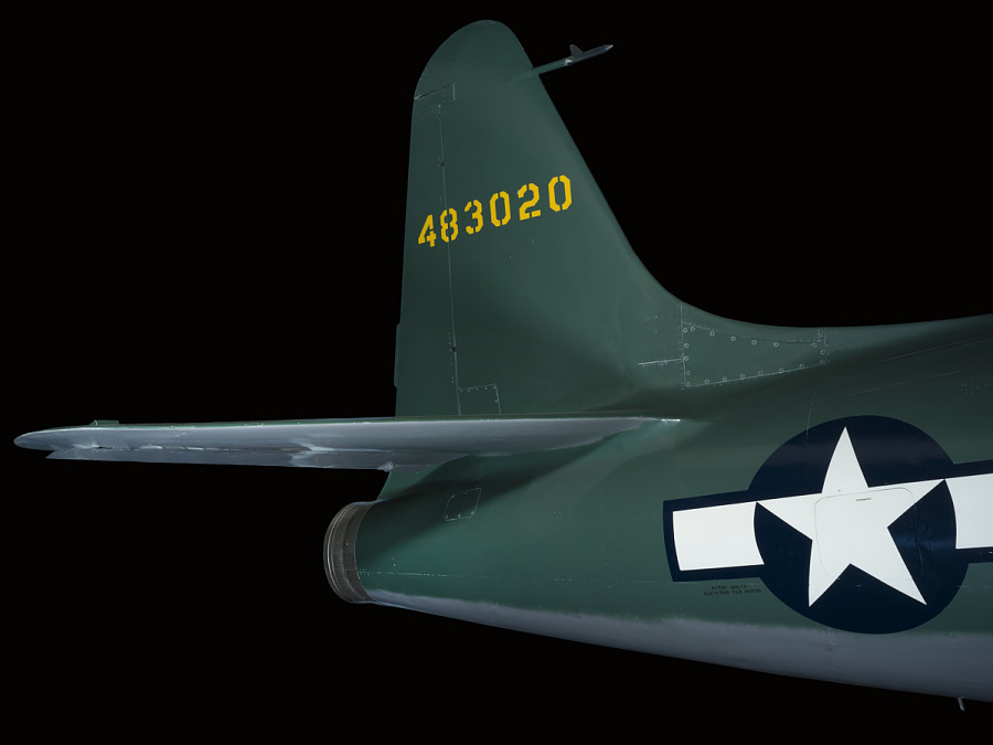 Tail of green Lockheed XP-80 'Lulu Belle' aircraft with United States Air Force insignia on                 body