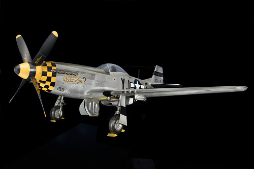 Overall view of gray and yellow checkered P-51 Mustang aircraft