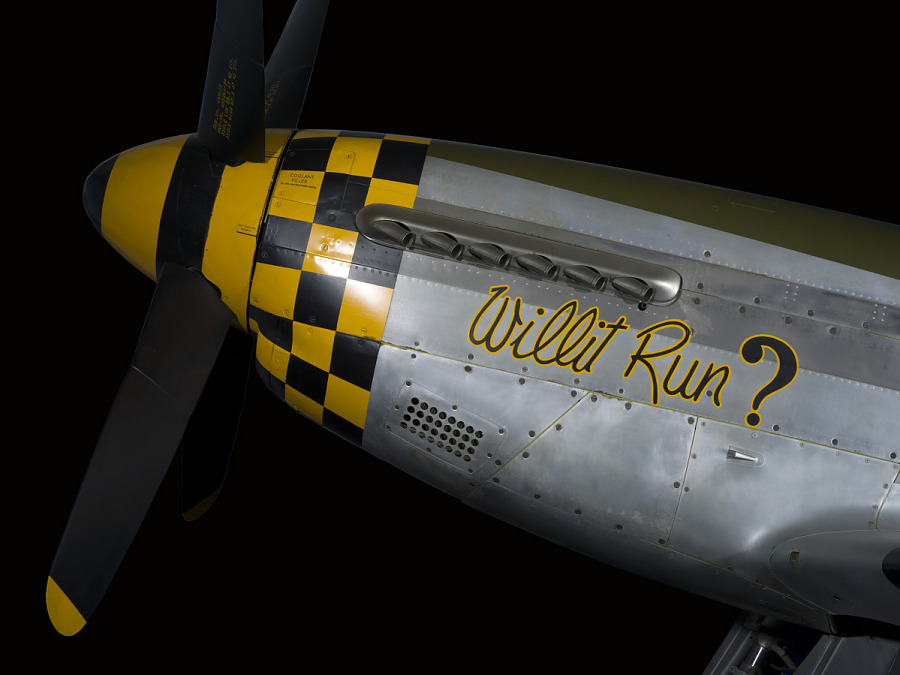 """Willit Run?"" in script on black and yellow checkered nose of P-51 Mustang aircraft"