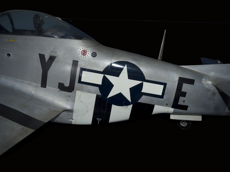 "United States Air Force insignia and ""YJ+E"" on body of P-51 Mustang aircraft"