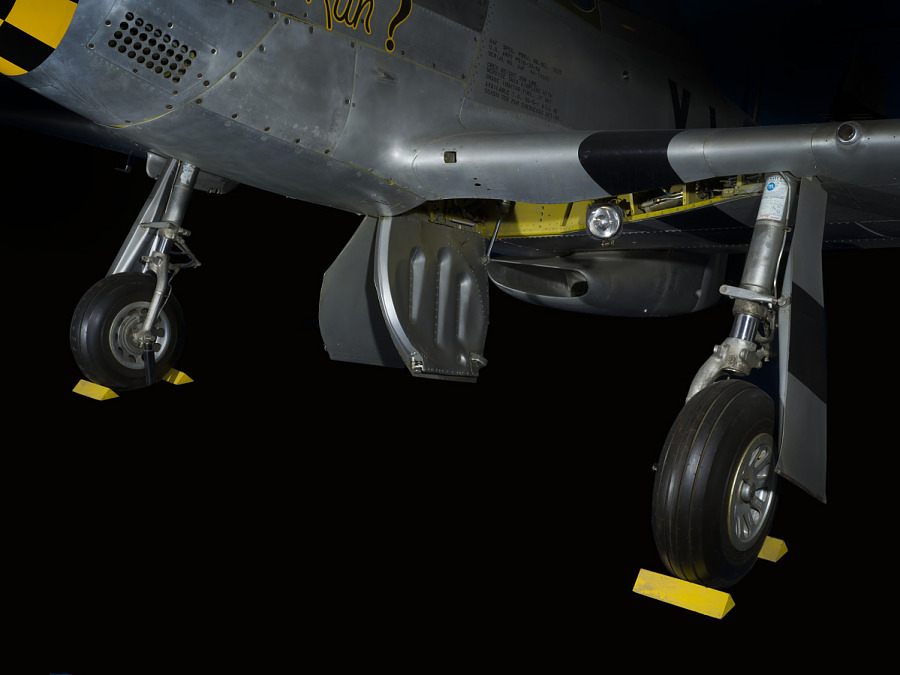 Two black wheels and landing gear of