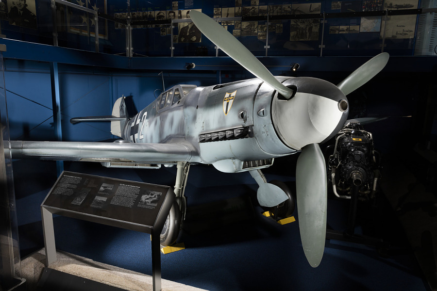 Front of gray Messerschmitt Bf 109 aircraft in museum