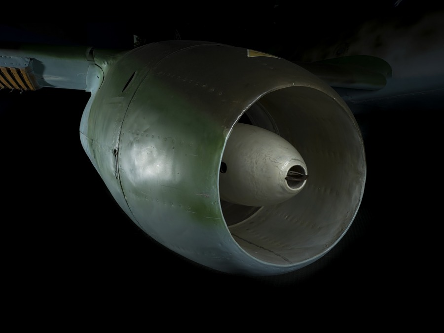 Round encased engine of green Messerschmitt Me 262 jet