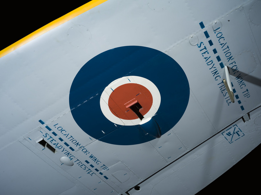 Underwing of green and blue Spitfire aircraft with Blue and red British roundel