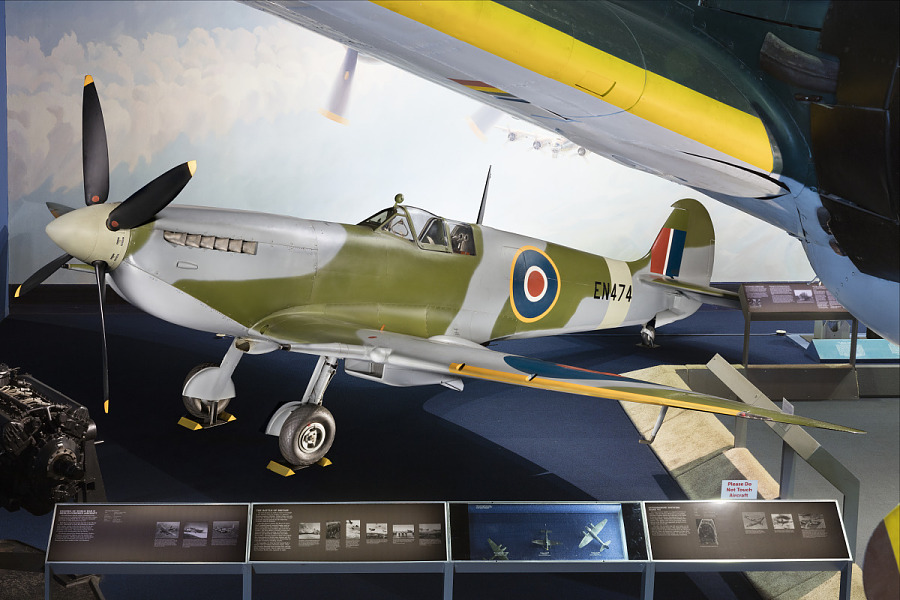 Green and blue Spitfire aircraft see on in display at museum