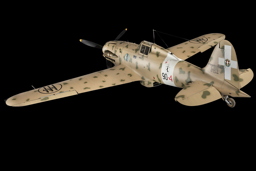 Side of tan Macchi C.202 Folgore aircraft