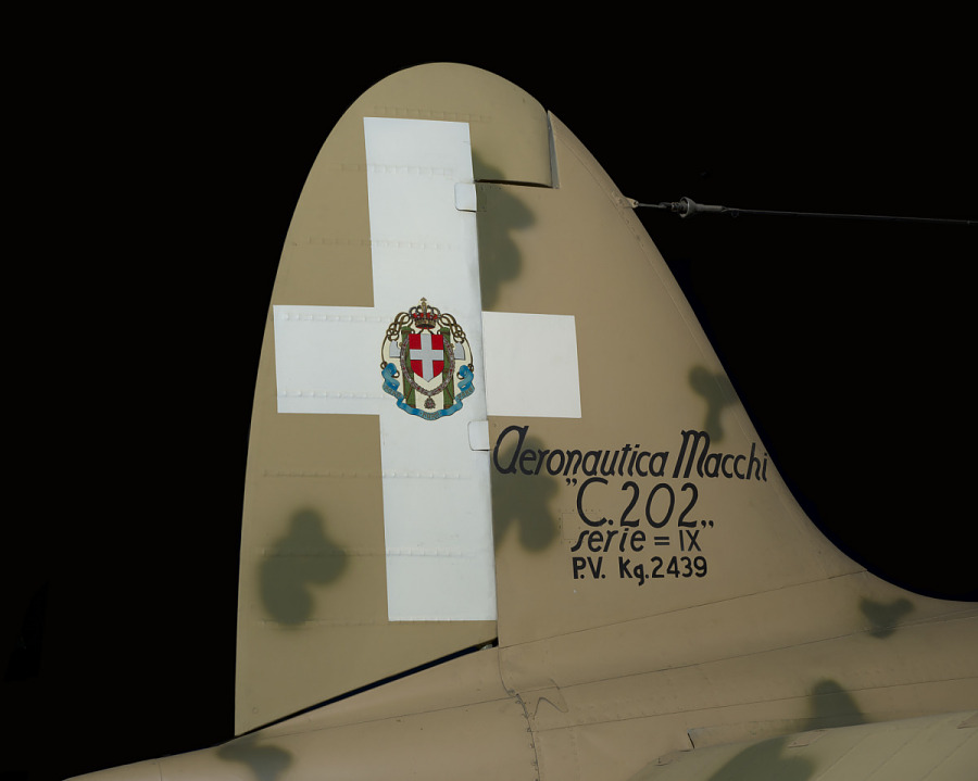 White cross with Facist emblem and name of aircraft on tail of Macchi C.202 Folgore aircraft