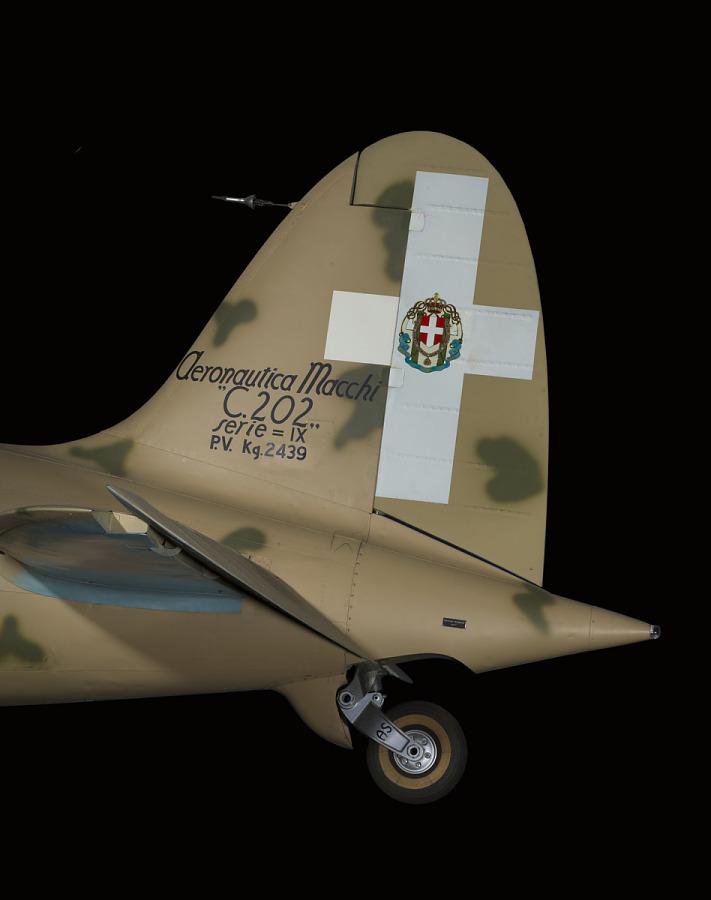 Tail and small rear landing wheel on tan Macchi C.202 Folgore aircraft