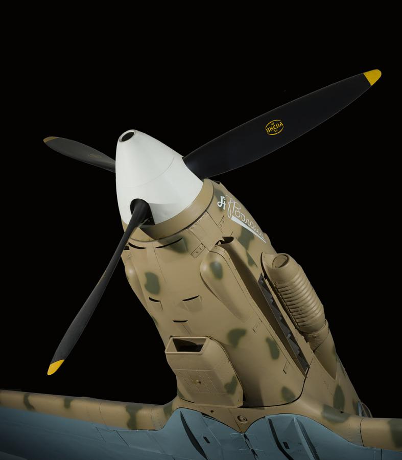 White nose and black three-blade propeller of tan Macchi C.202 Folgore aircraft