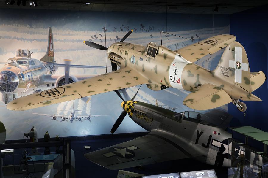 Rear of tan Macchi C.202 Folgore aircraft hanging in museum