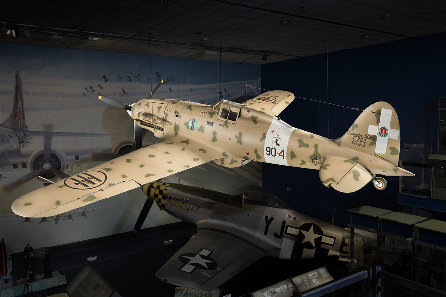 Side of tan Macchi C.202 Folgore aircraft hanging in museum