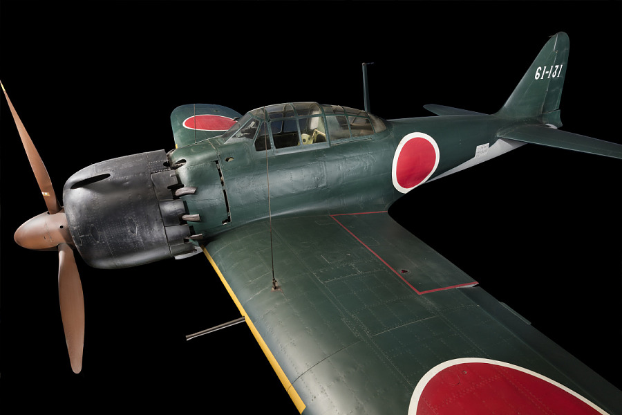 Side view of green tri-blade propellered Zero Fighter aircraft