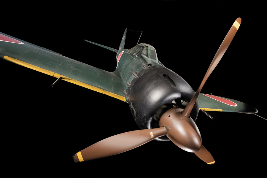 Front view of green tri-blade propellered Zero Fighter aircraft