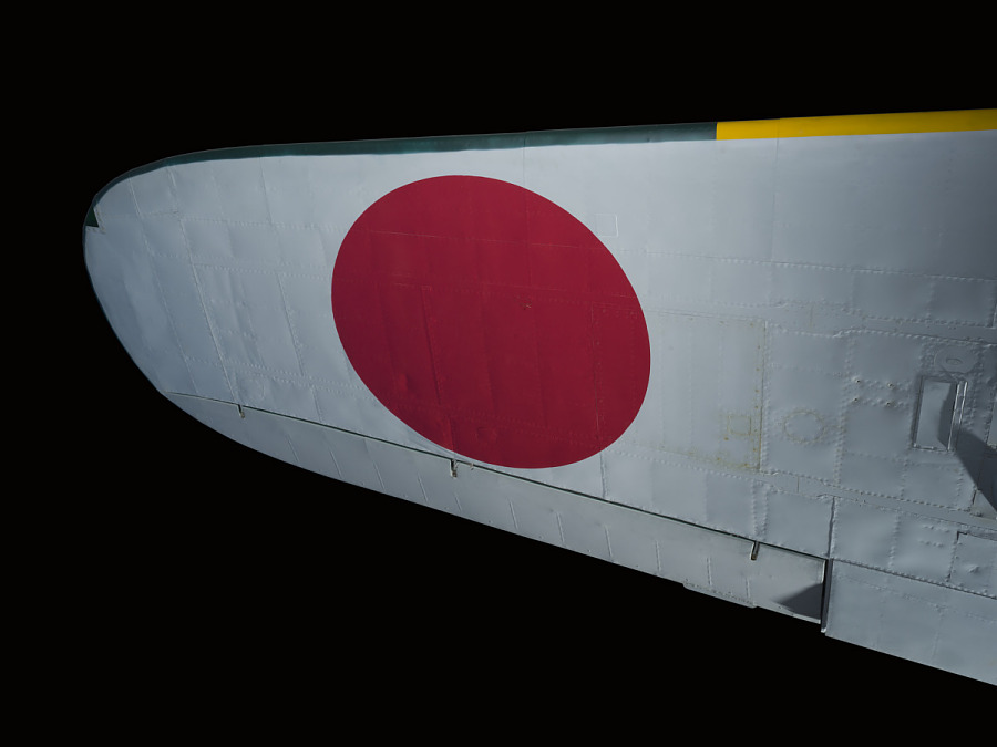 Red circle design on white underwing of Zero Fighter aircraft