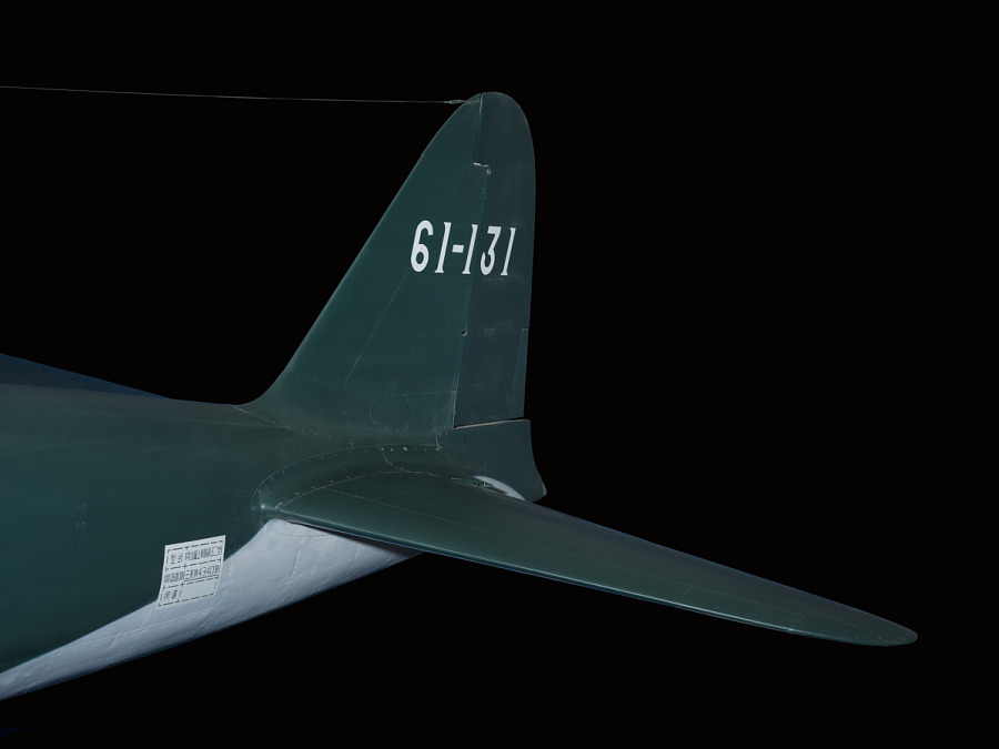 Tail of green Zero Fighter aircraft with '61-131' in white lettering