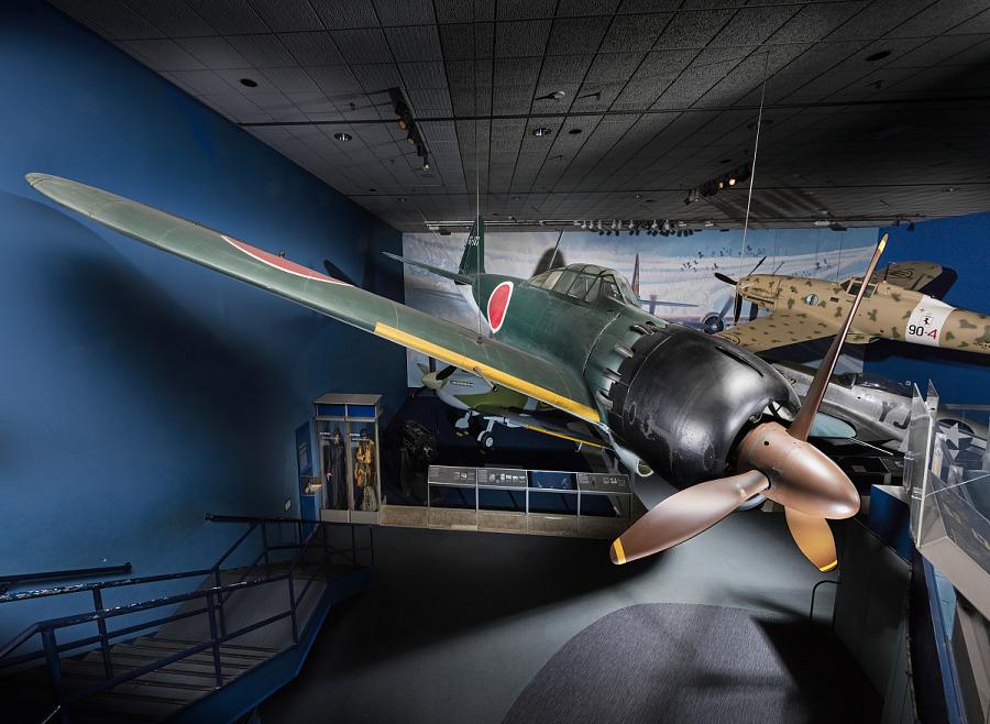 Green tri-blade propellered Zero Fighter aircraft on display in World War II Aviation gallery