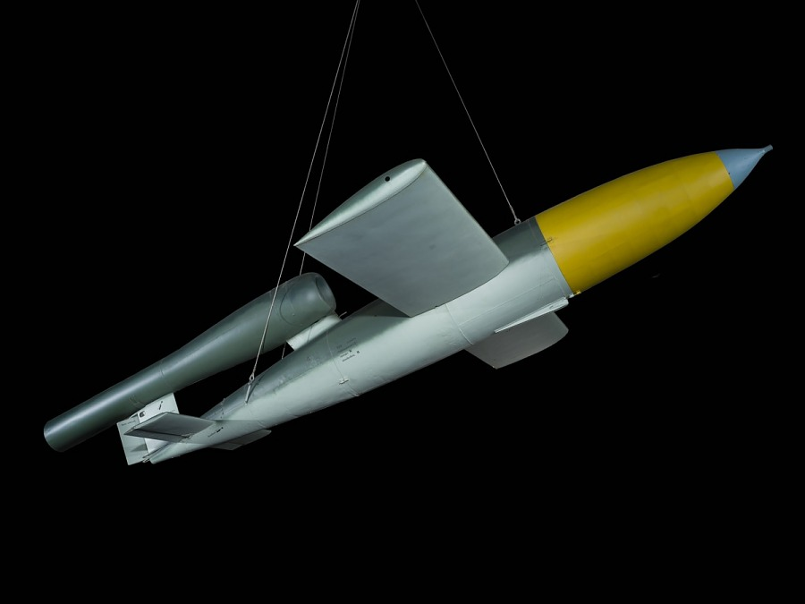 Side of sleek, silver cruise missle with wings, and yellow nose