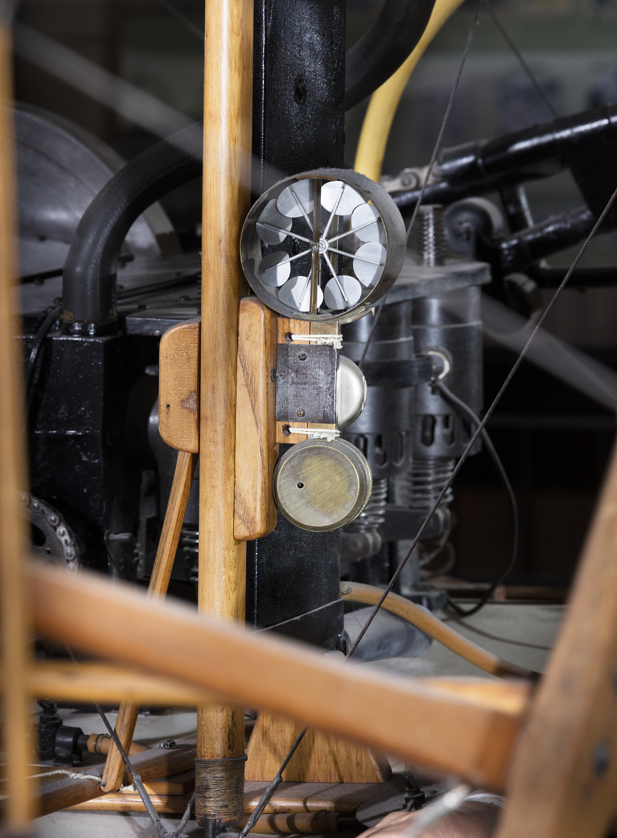 Metal circular wind mechanism attached to wooden frame in 1903 Wright Flyer