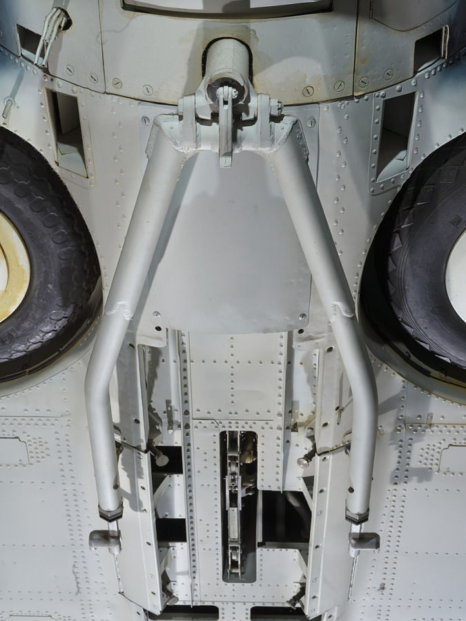Undercarriage of body of Douglas SBD-6 Dauntless aircraft with spare wheels and hinged                 apparatus