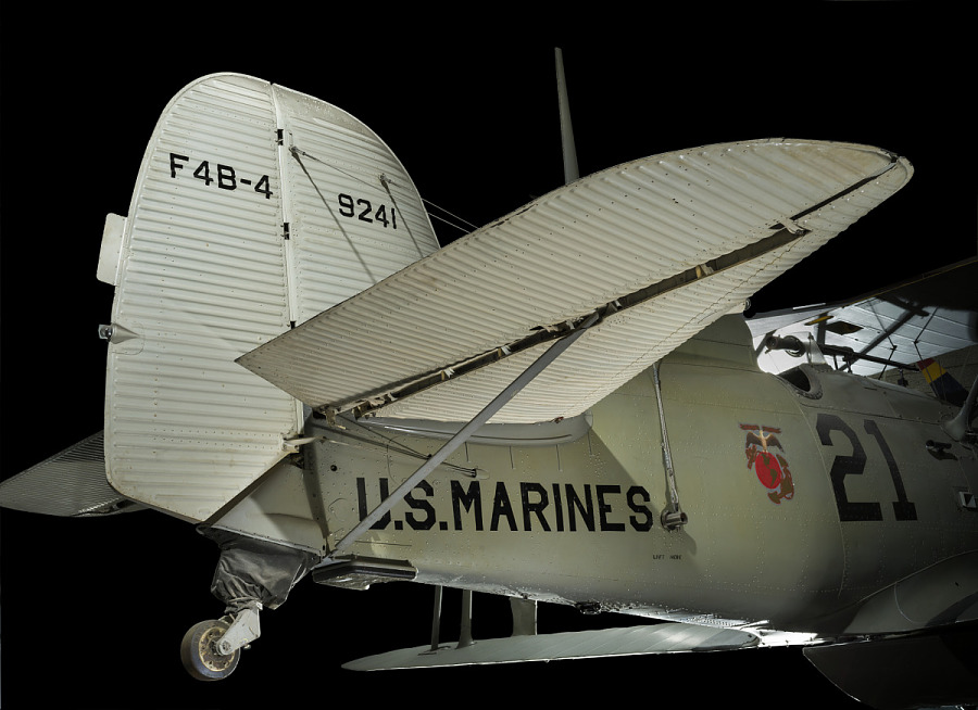 """Tail of Boeing F4B-4 with """"U.S. Marines"""" on body of aircraft and rear wheel"""