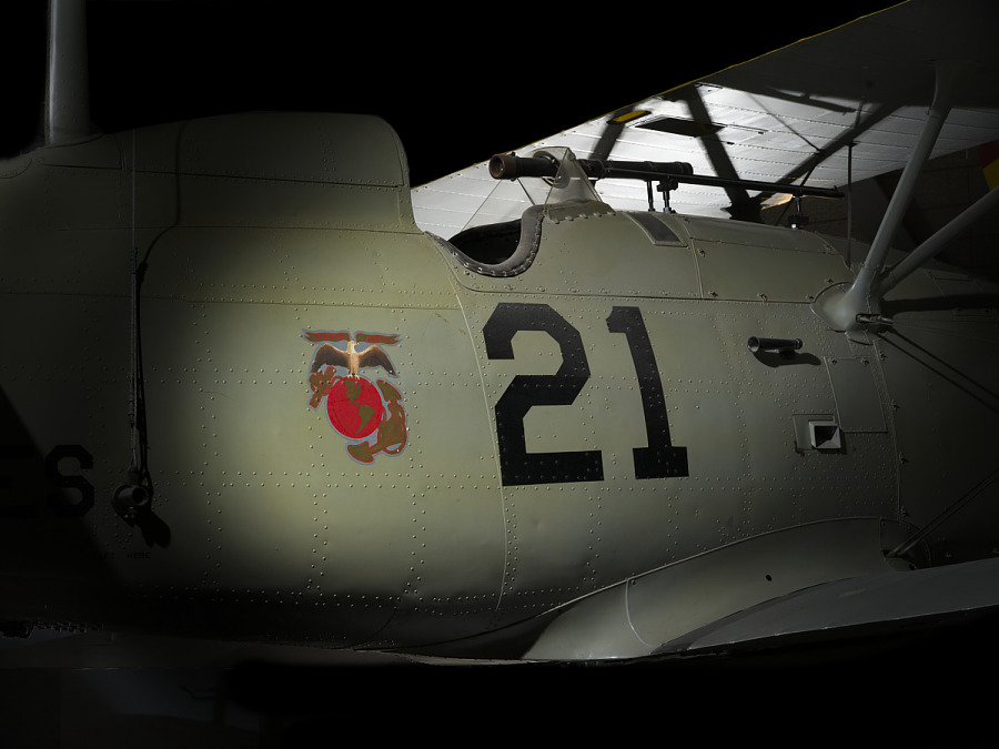 """Body of Boeing F4B-4 with Marine Corps Emblem and """"21"""" in black letters"""