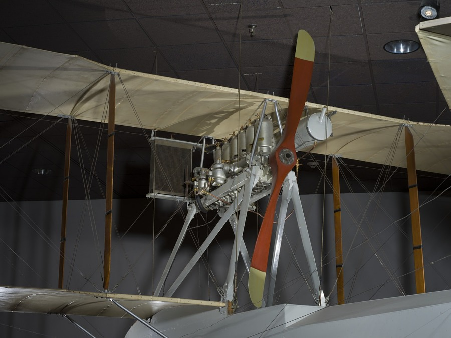 Wooden propeller and metal engine of Ecker Flying Boat hanging in museum