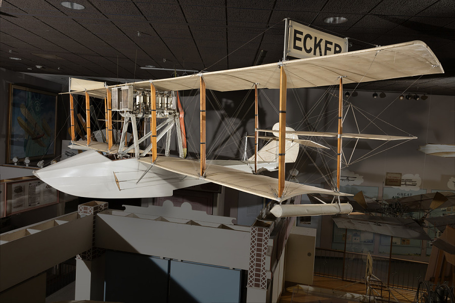 Cloth, wood, and metal Ecker Flying Boat hanging in museum