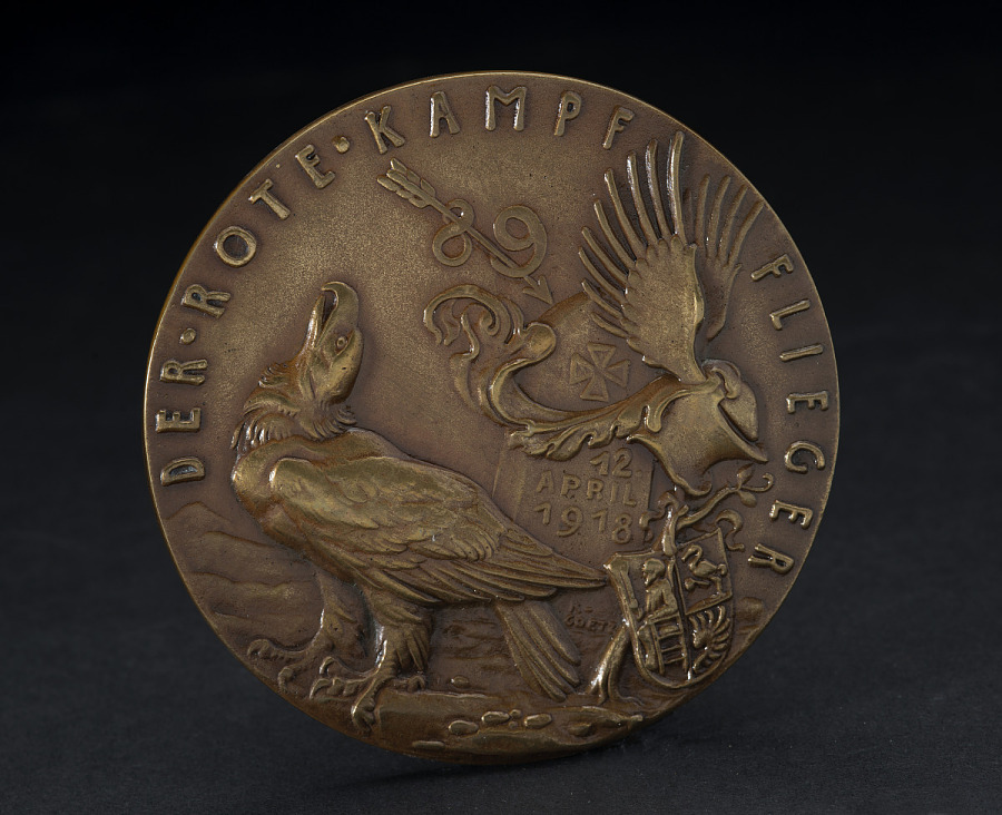 Back of bronze medal with eagle and shield insignia