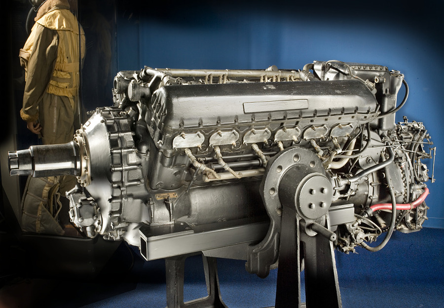 Long 12-cylinder metal engine in museum