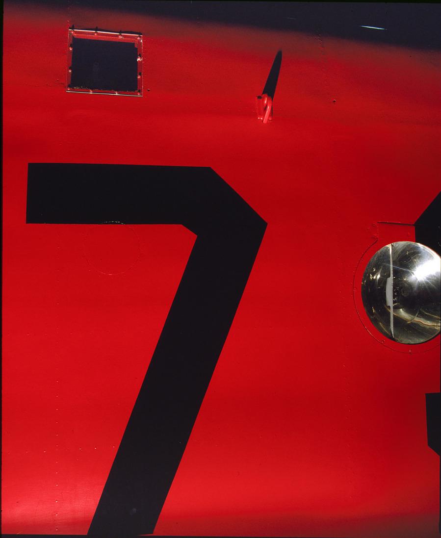 Close up of wing of red Amelia Earhart Lockheed Vega 5B aircraft