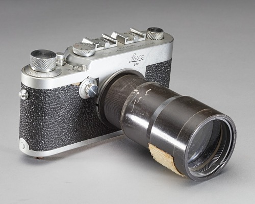 Black camera with long fixed focus lens