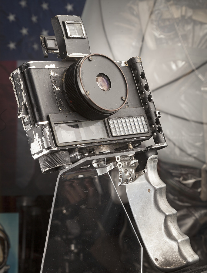 Black camera with large viewfinder and grip handle