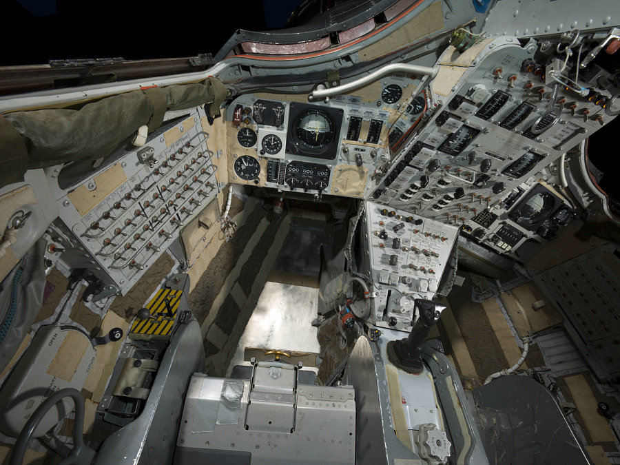 Interior view of the the instrument panels and seats of the vehicle.