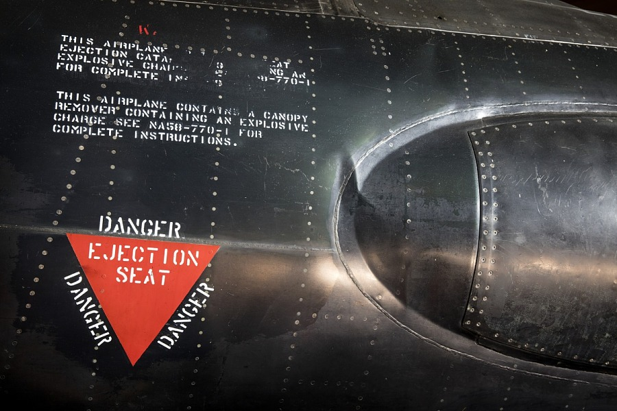 """Red triangle """"Danger Ejection Seat"""" label on side of black titanium North American x-15                 aircraft"""