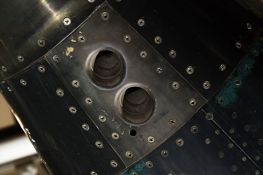 Two circular holes in body of black titanium North American X-15 aircraft