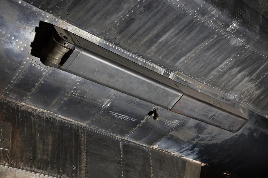 Black rectangular box-shaped attachment on body of black titanium North American X-15 aircraft