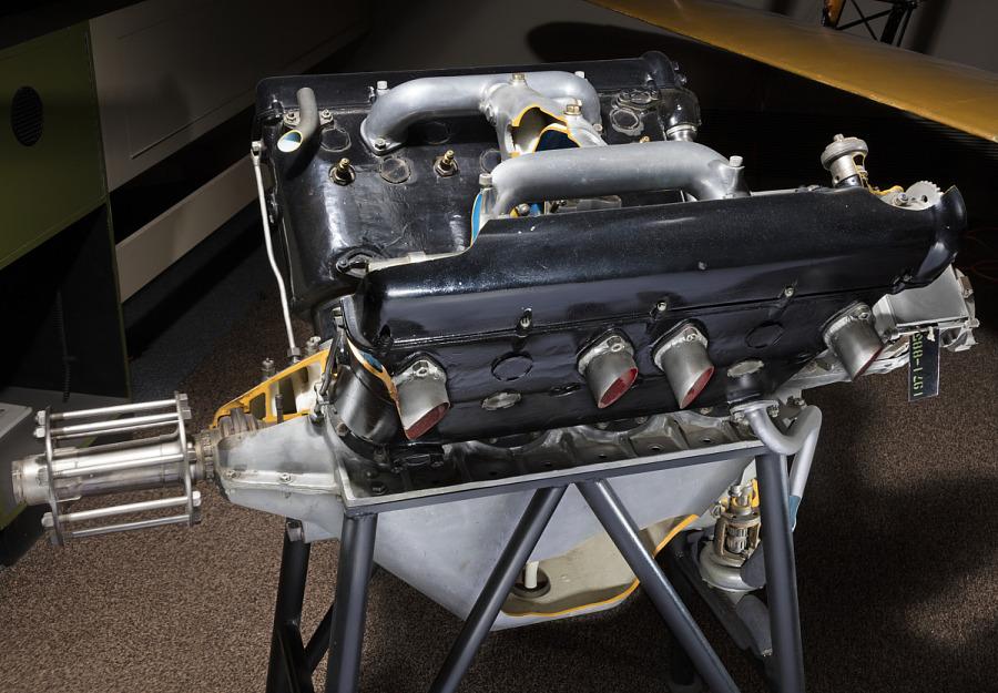 Side of open-book shaped black metal engine