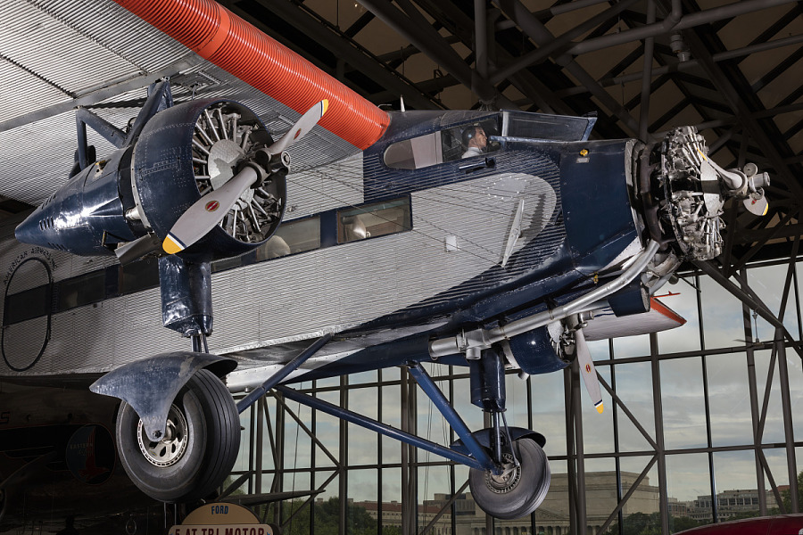 Front side and silver, red, and blue Ford 5-AT Tri-Motor aircraft hanging in museum