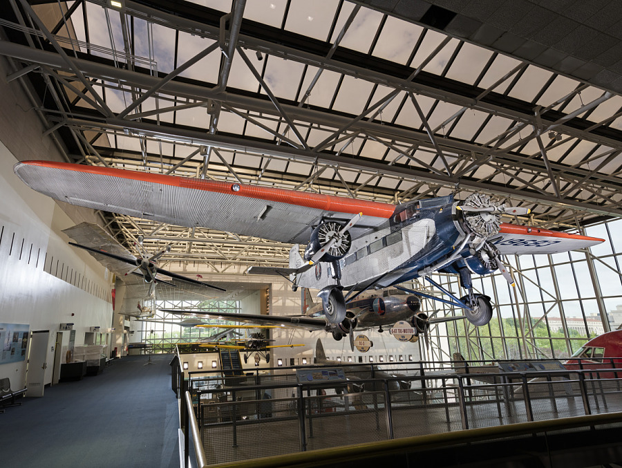 Silver, red, and blue Ford 5-AT Tri-Motor aircraft hanging in museum