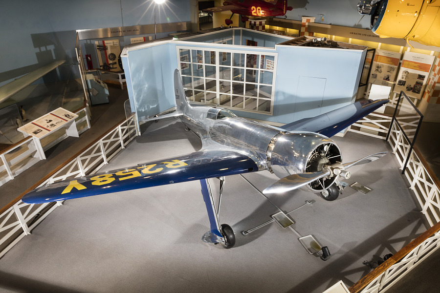 Top of metalic silver and blue Hughes H-1 Racer aircraft in museum